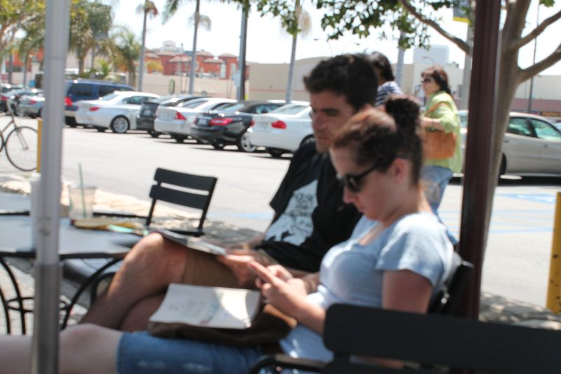 Browsing through e-mails and magazines at the Farmers Market